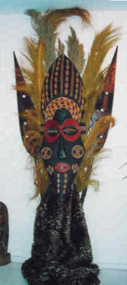african mask and grasses