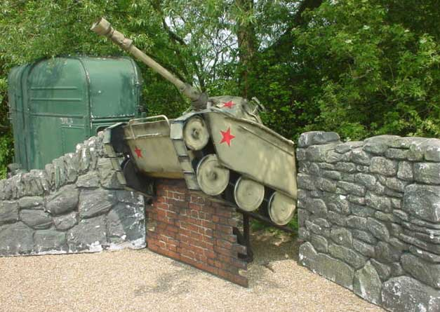 tank crashign through a wall