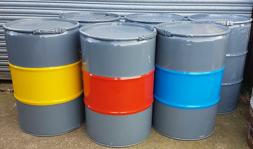 painted oil drums as posuer tables